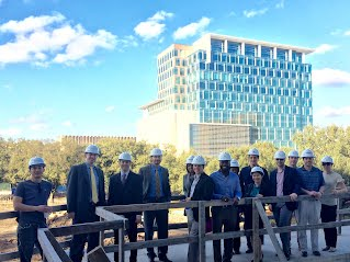 UH MBA & Rice MBA group shot with One Grove Street in the background.